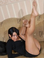Andrea exposing her legs in glossy and sheer pantyhose